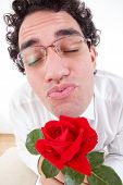 Romantic Man With Rose Giving A Kiss