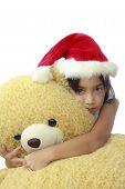 Pretty Little Asian Girl Hugging Big Bear