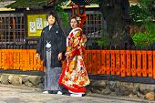 Unidentified young Japanese couple dressed in formal kimono.