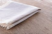 Napkin on wooden table, close-up