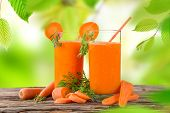Fresh carrot juice, healthy drinks on wooden table.