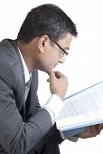 Young Businessman Reviewing The Office Report
