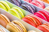 French colorful macarons in a rows