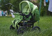 Baby Buggy On Green Grass
