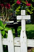 Picket fence with cross