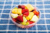 Bowl Of Fresh Whole And Cut Fruit