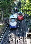 LUGANO, SWITZERLAND - JULY 5, 2014: Two funicular cars passing each other in Lugano. The Funicolare