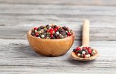Colored Pepper In The Wooden Bowl, On Wooden Board