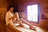 Pretty woman in  a hot sauna in Hotel