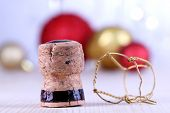 Champagne cork on champagne glasses background