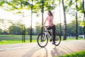 Young Woman On Bicycle