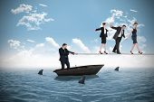 Young businessman pulling a tightrope for business people against sharks circling small boat in the