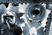 engineer with large gears and cogs powered by timing chain