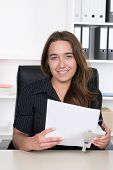Young Woman Is Punching Documents