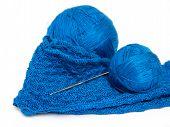 Blue yarn ball, crochet piece and crochet hook