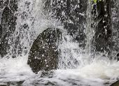 Water Splashing On Big Stone