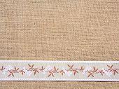 Burlap background with ribbon