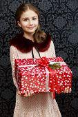 Merry Christmas, Christmas gift - girl with christmas present