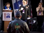 NEW YORK - NOV 11, 2014: A Vietnam Vet stands facing the VIP stage during the 2014 America's Parade held on Veterans Day in New York City on November 11, 2014.