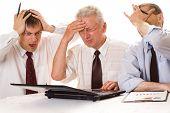 Three Businessmen Working Together