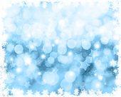 Christmas background with snowflake border and bokeh lights