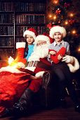 Santa Claus brought gifts for children. Christmas scene.