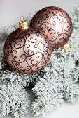 Christmas ball with snowbound fir-tree