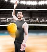 Volleyball player on gray uniform on volleyball court