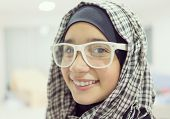 Young Muslim Arabic female in head scarf with modern clothes
