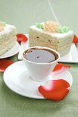 sweet breakfast : whipped cream on sweet cake with hot black coffee
