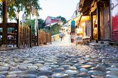 Old Mostar city town street by evening