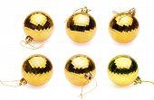 yellow christmas balls on white background