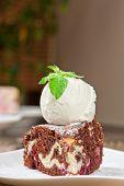 A slice of chocolate cake with ice cream