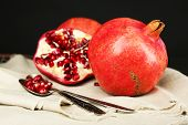 Juicy ripe pomegranates on dark background