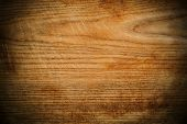 Wood panel or veneer background texture with decorative woodgrain and vignetting, a natuiral building material for interior decor