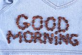 Sign  Good Morning made of coffee beans on jeans background