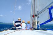 Father and kids sailing on a luxury yacht or catamaran boat