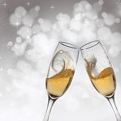 Toasting with two champagne glasses on abstract bokeh background