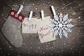 Happy new year- decorations and cards hanging on clotheslines