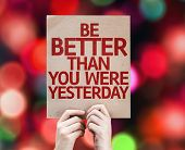 Be Better Than You Were Yesterday card with colorful background with defocused lights