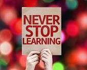 Never Stop Learning card with colorful background with defocused lights