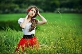 Beautiful smiling girl on cereal field in spring