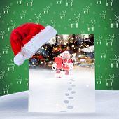 Santa hat on poster against santa delivering gifts in city