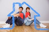 Couple holding a broken heart against house outline