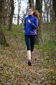 Young Sports Woman Running on the Trail in the Wild Forest. Active Lifestyle