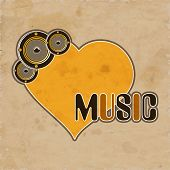 Stylish text of Music with yellow heart shape and speakers on grungy background.