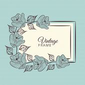 White vintage frame with floral decoration on blue background.
