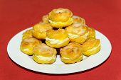 Cream Puff Pile On White Plate