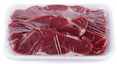Market packaged raw meat isolated on white background.