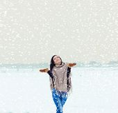 beautiful happy smiling girl woman walking in a field on a winter evening and happy snow